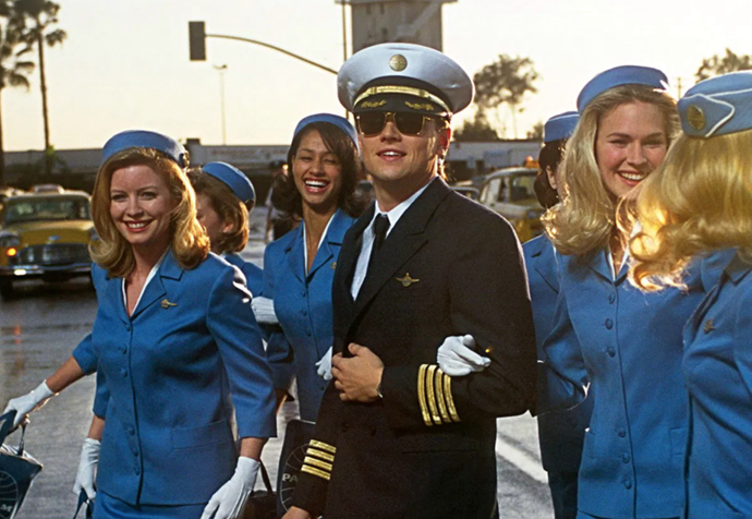 ***Catch Me If You Can* (2002)** <br><br> Another true story, based on the notorious con-artist Frank Abagnale, this classic con film stars a young Leonardo DiCaprio as Frank, an ambitious and wily scammer who becomes a master at the art of deception, and Tom Hanks as the FBI agent who wants to see him behind bars.