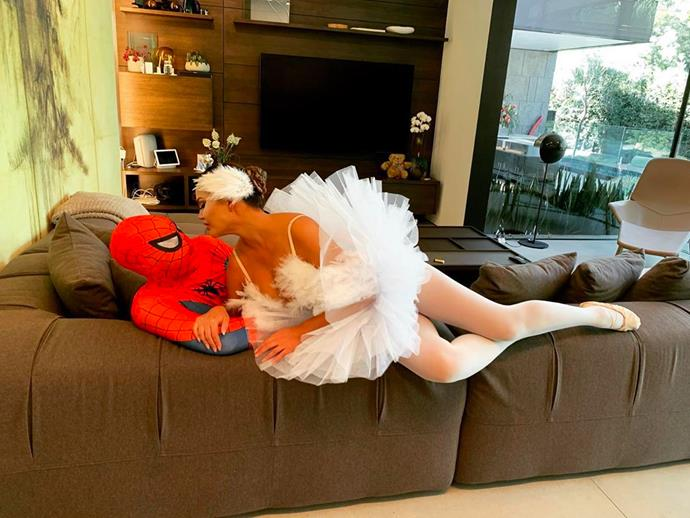 Chrissy Teigen and John Legend as Spiderman and Black Swan.