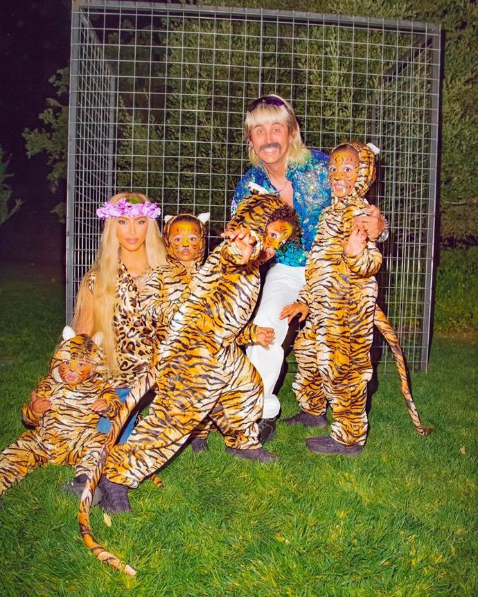 Kim Kardashian and Jonathan Cheban with North, Saint, Chicago and Psalm as *Tiger King*'s Joe Exotic, Carole Baskin and their tigers.