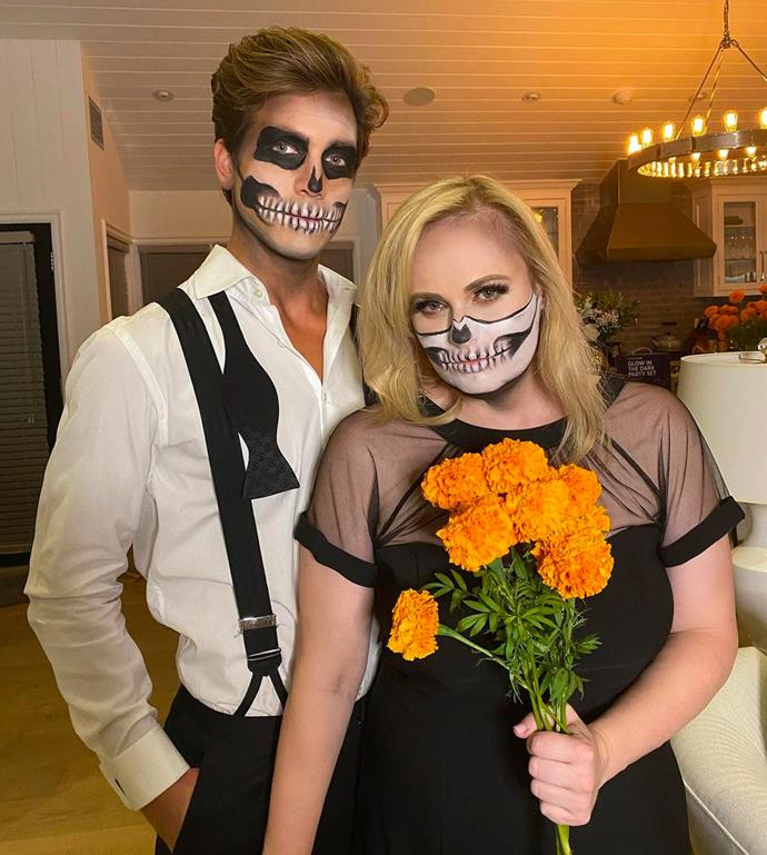 Rebel Wilson and Jacob Busch as skeletons.