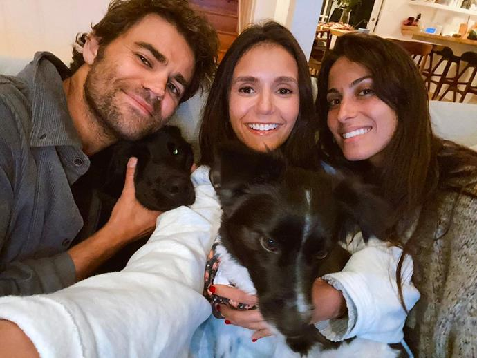 """***The Vampire Diaries*** <br><br> Nina Dobrev and Paul Wesley and his wife, Ines de Ramon, reunited for a nostalgic snap [on Instagram](https://www.instagram.com/p/CE2ApkbAN9A/