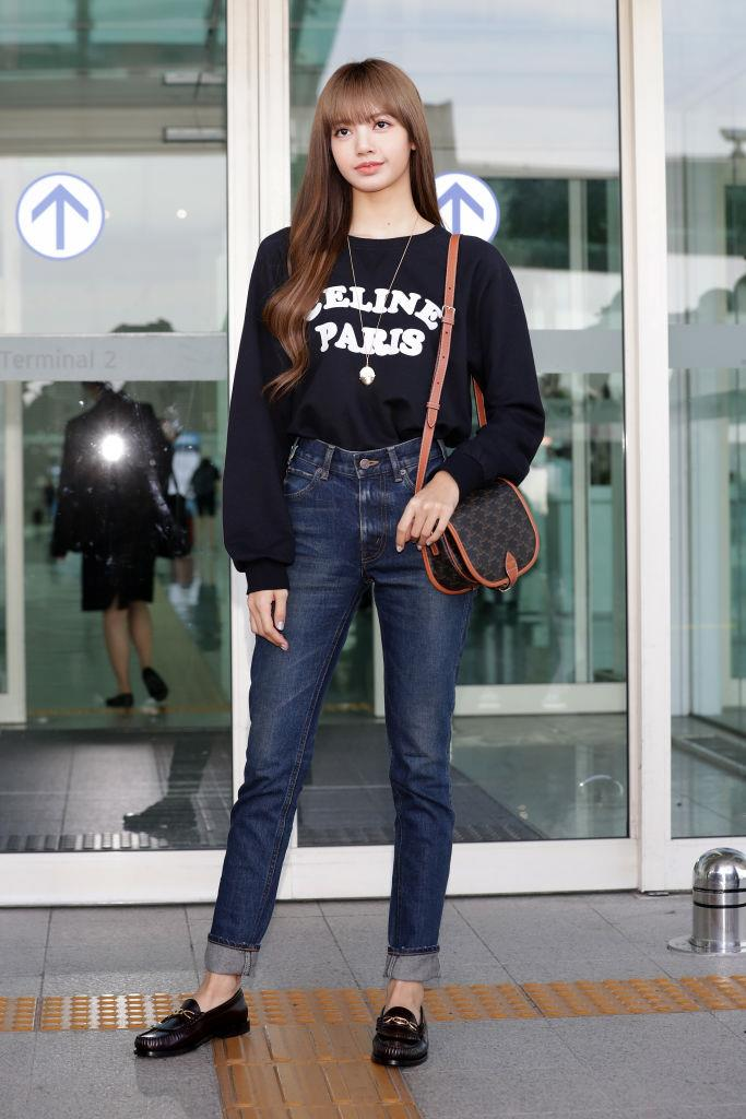**Lisa**<br><br>  In Celine and classic denim at the Incheon International Airport in September 2019 in Incheon, South Korea.