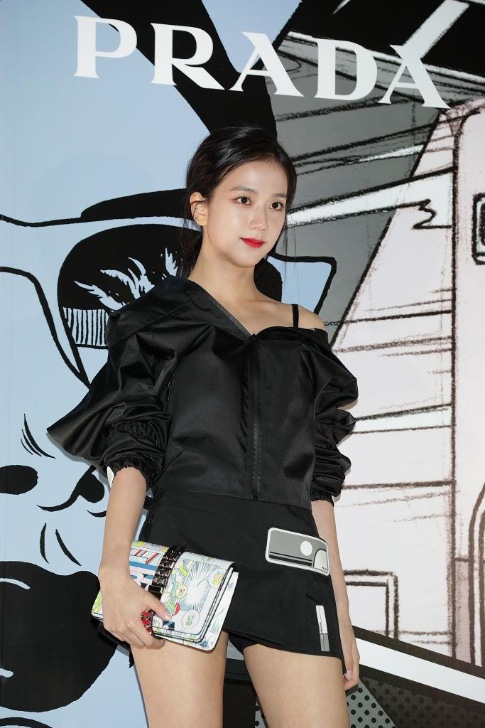 **Jisoo**<br><br>  Adding a playful pop with a statement clutch at at a Prada event in Seoul in February 2018.