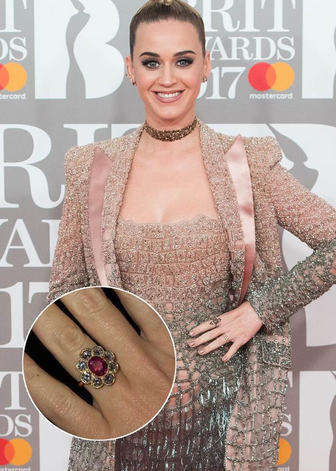 **Katy Perry**<br><br>  Katy Perry received this daisy-style ring with a ruby at the centre from Orlando Bloom.