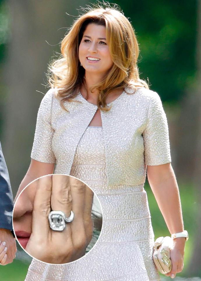 **Mirka Federer**<br><br>  Mirka Federer, wife of tennis champion Roger Federer, has one grand slam of an engagement ring, featuring an emerald-cut diamond ring encircled by a distinct snake-like band, covered in several more tiny diamonds in a white-gold or platinum setting.