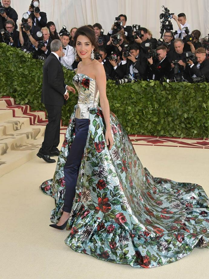 "**Amal Clooney's floral Richard Quinn at the Met Gala (2018)** <br><br> For her first Met Gala as an event co-chair, human rights barrister Amal Clooney attended in a gown/trousers design by British designer Richard Quinn. However, it was later revealed that the look was actually Clooney's second outfit choice for the Catholic-themed gala, and that she changed into her first choice—a different, stain glass window-inspired Tom Ford gown—while inside the Met Museum's gift shop. <br><br> *[Page Six](https://pagesix.com/2018/05/15/amal-clooney-infuriates-tom-ford-with-met-gala-outfit-change/|target=""_blank""