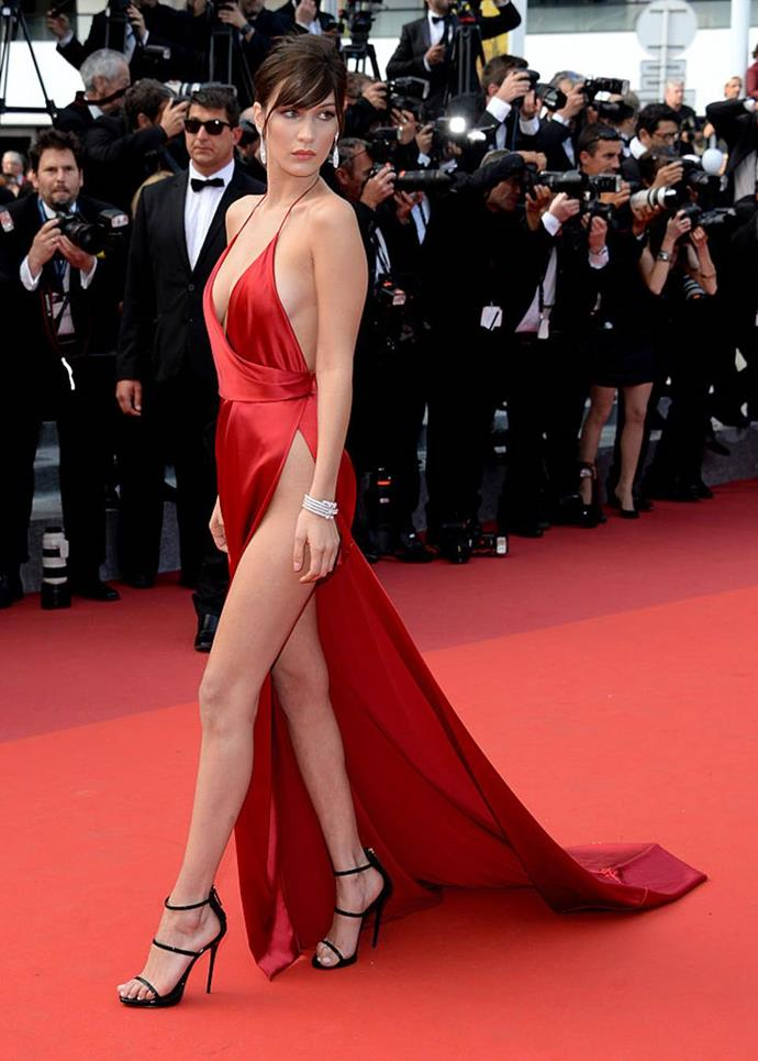 "**Bella Hadid's risky Alexandre Vauthier dress at the Cannes Film Festival (2016)** <br><br> On the [Cannes Film Festival red carpet](https://www.harpersbazaar.com.au/fashion/best-cannes-red-carpet-dresses-history-20290|target=""_blank""), supermodels usually go just as all-out as the actors do, but few Cannes looks have topped Bella Hadid's 2016 look in sheer risk-factor. With an astronomically-high side split, Hadid's Alexandre Vauthier gown was dangerously close to a wardrobe malfunction, and that was exactly how she wanted it. <br><br> While it appeared as though one unforgiving gust of wind could've derailed the whole look, Vauthier thought ahead and included a built-in bodice, so as to prevent any unwanted exposures from happening."