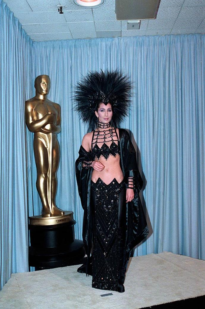 "**Cher in Bob Mackie at the Academy Awards (1986)** <br><br> For the 1986 Oscars, Cher consulted her close friend, costume designer Bob Mackie, to create this bespoke, sequinned outfit and headpiece. Aside from revealing her then-boyfriend, Joshua Donen, ""almost passed out"" after he saw the look, Cher also revealed the look was a statement against the Academy, who she believes didn't see her worth as an actress. <br><br> ""I had the idea [of wearing the dress] mostly because the Academy didn't really like me. They hated the way I dressed and I had young boyfriends and they just thought I wasn't serious,"" the performer said in a 2019 [interview](https://www.youtube.com/watch?v=ElSJb6CmS3c