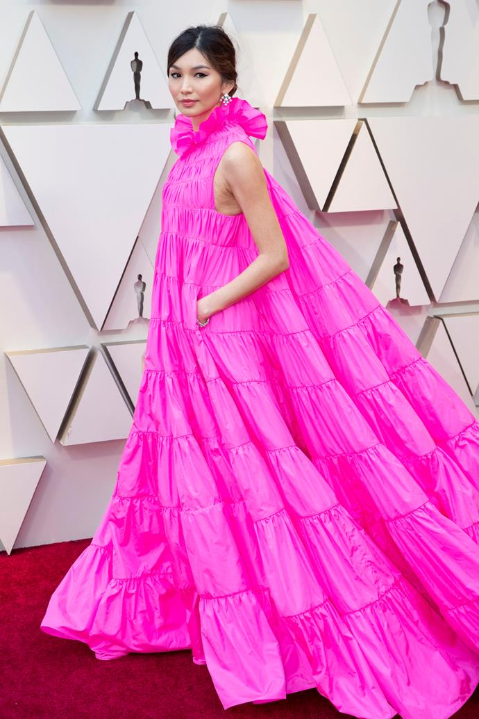 "**Gemma Chan's ruffled Valentino Haute Couture at the Academy Awards (2019)** <br><br> Red carpet fashion often forsakes practicality to make way for chicness, but Gemma Chan had it both ways with her stunning pink Valentino gown (from the brand's Haute Couture spring summer '19 collection) at the 2019 Oscars. <br><br> In an interview with *[Entertainment Tonight](https://twitter.com/etnow/status/1099925475076390919|target=""_blank""
