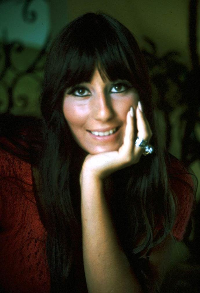 **1970: Long, blunt fringes**<br><br>  The '70s was synonymous with long hair, and thanks to Cher, the long, blunt fringe was no exception.