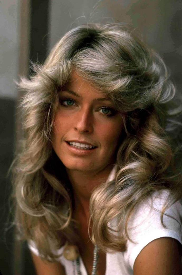 **1977: Farrah Fawcett's famous flicks**<br><br>  After rising to fame as one of the original *Charlie's Angels*, Farrah Fawcett's signature flicks became one of the most coveted hairstyles in history.