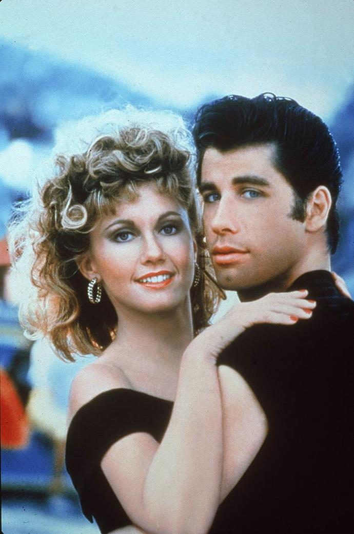 """**1979: Sandy's bad-girl perm from** ***Grease***<br><br>  Big 'bad girl' curls took the beauty world by storm in 1979 after Olivia Newton John's [unforgettable makeover scene](https://www.harpersbazaar.com.au/culture/best-movie-makeovers-18240