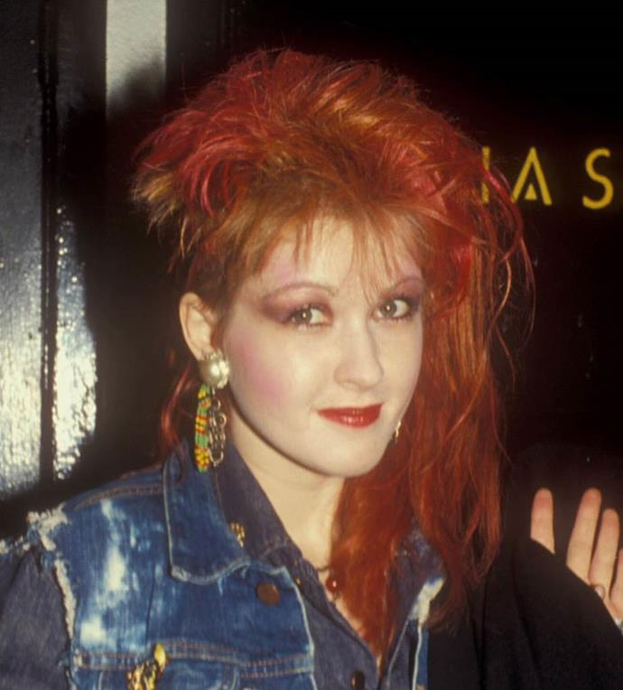 **1984: Colour-blocked makeup**<br><br>  Pairing graphic eyes with bold lips (and in Cyndi Lauper's case, the side-mullet hairstyle) became the norm as the mid '80s approached.