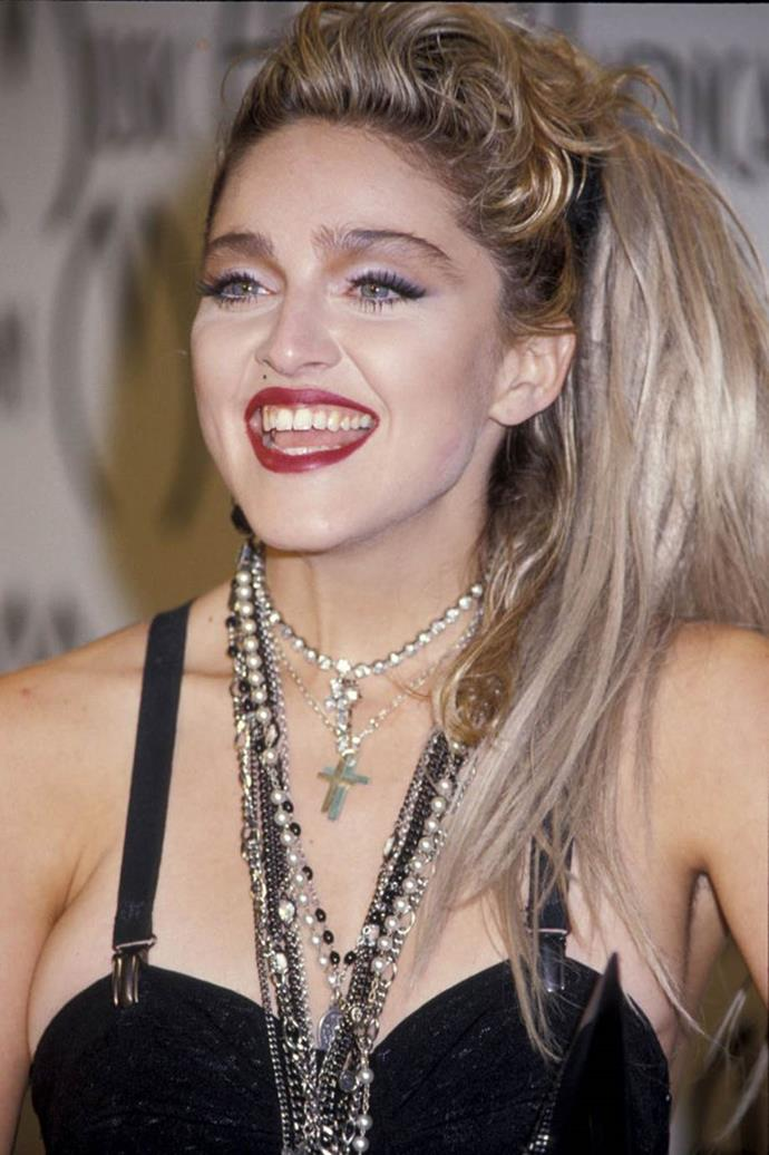 **1985: Teased side-ponytails**<br><br>  Madonna was one of the '80s biggest trendsetters, so it's no surprise that the *Material Girl's* teased side-ponytail became one of 1985's most popular looks.