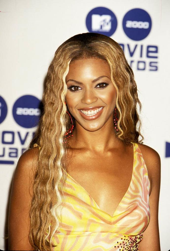 **2000: Two-tone highlights and crimped hair**<br><br>  Leave it to Beyoncé, ever the over-achiever, to encapsulate two of 2000s' biggest hair trends at once, namely: crimped locks and chunky, two-tone highlights.