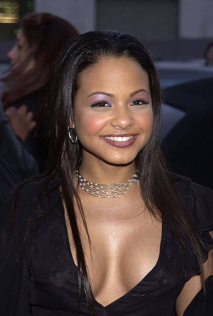 **2002: Shimmery Purple Shadow**  The purple eyeshadow of 1997 experienced a resurgence in 2002, when stars like Christina Milian began rocking the look on the red carpet with an added touch of shimmer.