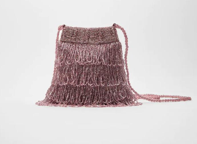 "Bucket Bag with Beaded Fringing, $69.95 by [Zara](https://www.zara.com/au/en/bucket-bag-with-beaded-fringing-p16783510.html?v1=52046547&v2=1277497|target=""_blank""|rel=""nofollow"")."