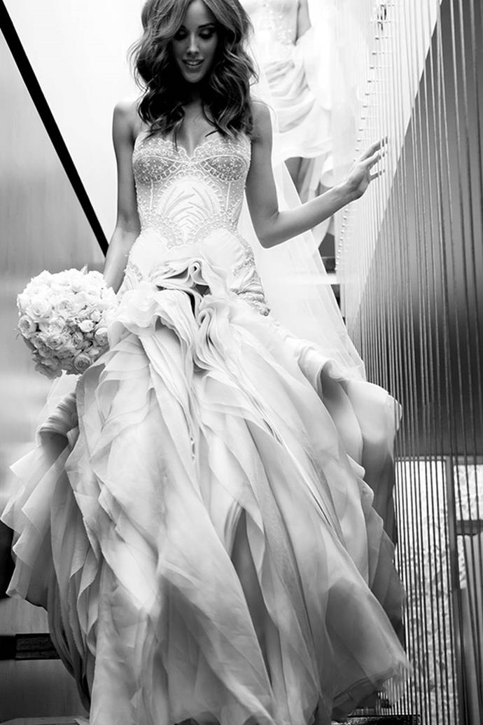"""**Rebecca Judd**<br><br>  Rebecca Judd in her J'Aton Couture wedding dress at her 2010 New Year's Eve wedding to AFL star Chris Judd.<br><br>   *Image via [rebeccajuddloves.com](https://www.rebeccajuddloves.com/2012/12/12/the-rebecca-gown-2/