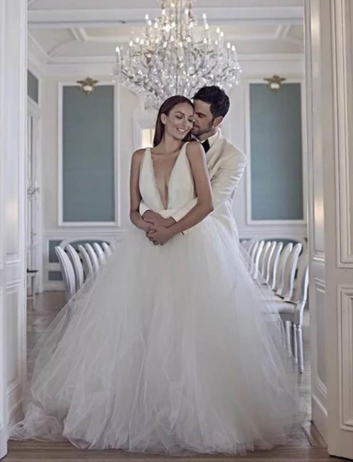 """**Ricki-Lee Coulter**<br><br>  Singer Ricki-Lee Coulter in her plunging tulle Johanna Johnson gown at her [2015 Paris wedding](https://www.nowtolove.com.au/lifestyle/weddings/ricki-lees-wedding-album-33278
