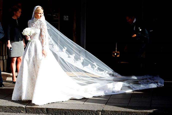 "**Nicky Hilton Rothschild** <br><br> For her 2015 wedding to billionaire James Rothschild, Hilton looked ethereal in a [Valentino](https://www.harpersbazaar.com.au/fashion/naomi-campbell-valentino-18001|target=""_blank"") Haute Couture gown. Besides looking amazing, the socialite was caught in a momentary crisis when her veil was caught under the wheel of a parked car en route to the ceremony. Thankfully, her assistants pulled it out from underneath before anything went wrong. <br><br> *Image: Getty*"