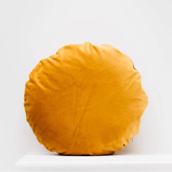 "'Velvet Round Throw Cushion' in Gold, $95 at [Pop & Scott](https://www.popandscott.com/collections/homewares/products/throw-cushion-velvet-round?variant=8230510166105 target=""_blank"" rel=""nofollow"")."