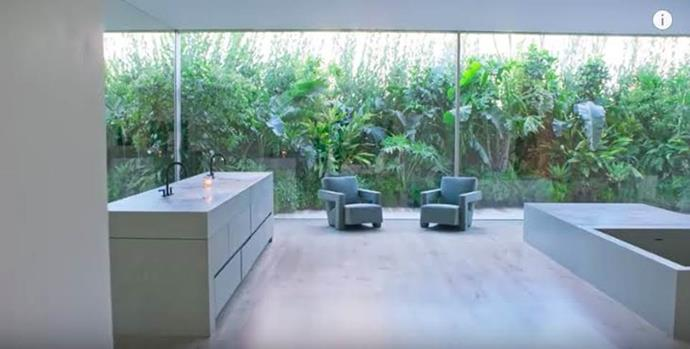 """**Kim Kardashian and Kanye West's house** <br><br> The Wests showed off their home's master bathroom in a video interview in April 2019, which involves a deep, plunging bathtub and a scenic outlook—as well as a rather perplexing set of bathroom sinks, which KKW later had to take to Instagram to debunk. <br><br> *Image: [YouTube](https://www.youtube.com/watch?v=QaZ93sibpk0&feature=emb_title