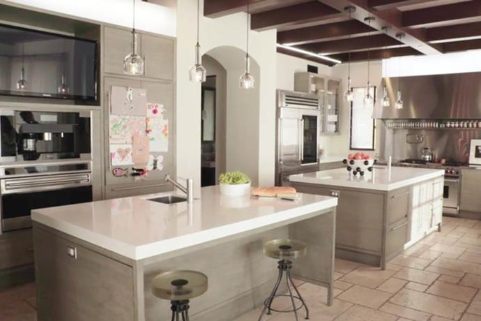 **Kourtney Kardashian's house** <br><br> Unlike Kris Jenner and Kim Kardashian West's homes, Kourtney's kitchen integrates plenty of wood and eclectic accessories, which are complemented by unevenly laid stone floors. <br><br> *Image: Kourtney Kardashian App*