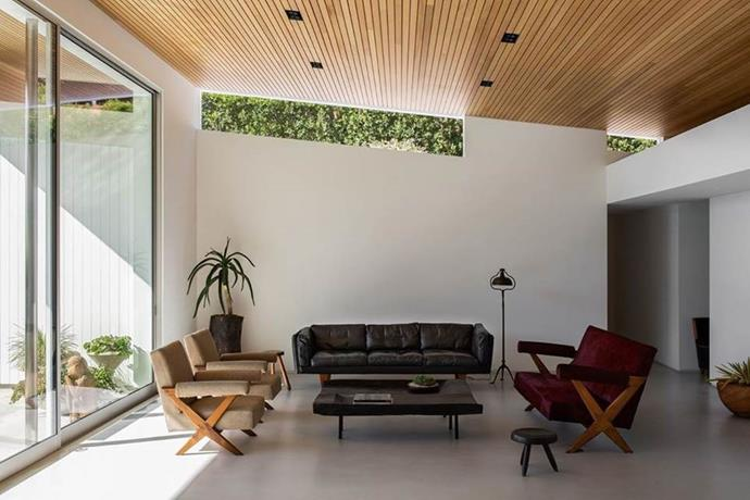 Another shot of the living room, featuring a hard concrete floor and wooden roof.