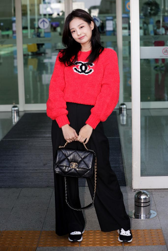 **Jennie**<br><br>  Rocking a red Chanel jumper at the Incheon International Airport in September 2019 in Incheon, South Korea.