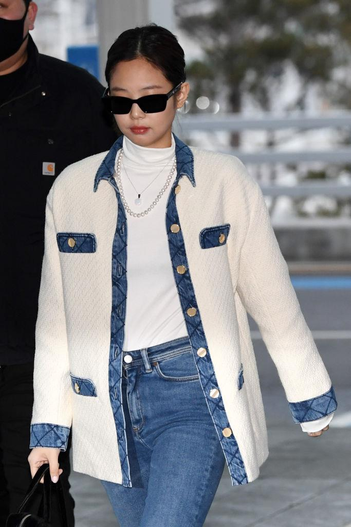 **Jennie**<br><br>  In pearls, Chanel and denim at the Incheon International Airport in February 2020 in Incheon, South Korea.