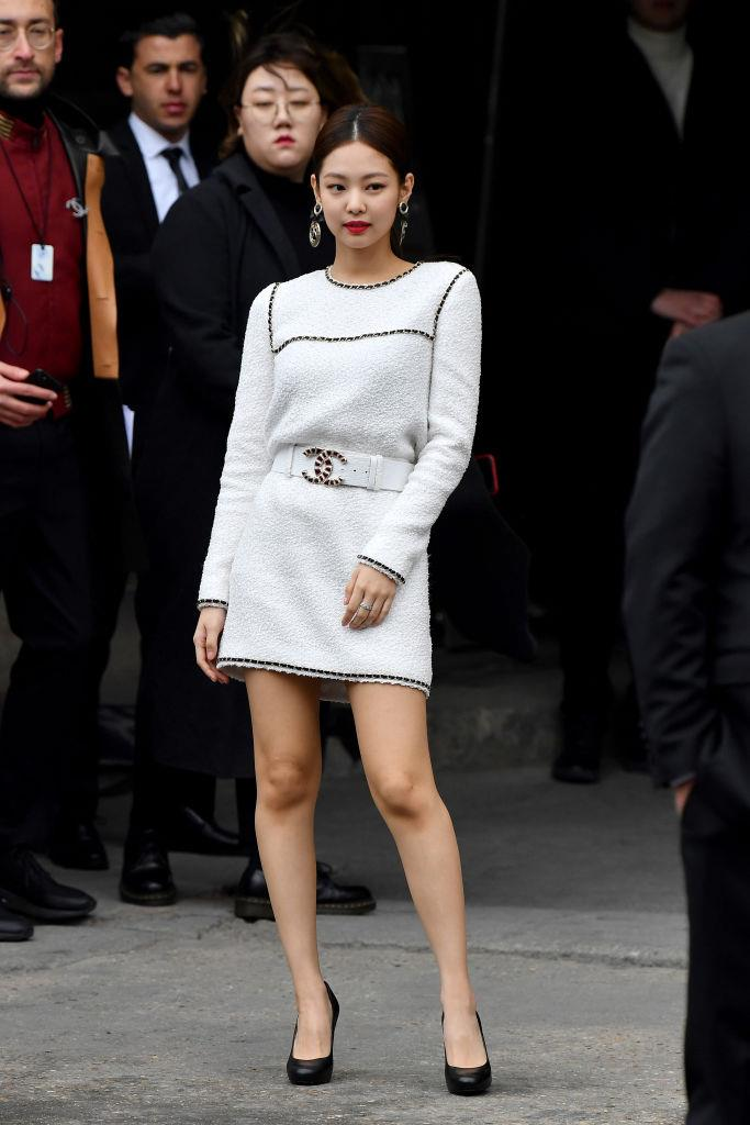 **Jennie**<br><br>  In a chic white Chanel minidress before the Chanel Women's spring/summer 2020 ready-to-wear collection fashion show at the Grand Palais in Paris in October 2019.