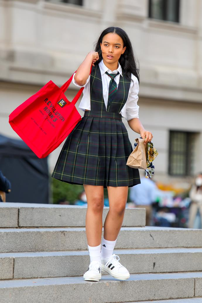 **The Constance and St Jude's School Uniforms**<br><br>  If Jordan Alexander is going to be the new Queen Bee, we're putting our Monopoly money on Whitney Peak (pictured here) being the new 'Little J'. Wearing her uniform in the more traditional fashion (much like Jenny did before she went all raccoon eyeliner), carrying her lunch in a paper bag and 'accessorising' with a shopping bag for progressive bookstore Revolution Books and adidas Beyoncé X Superstar platform sneakers? She's definitely one to keep an eye on.