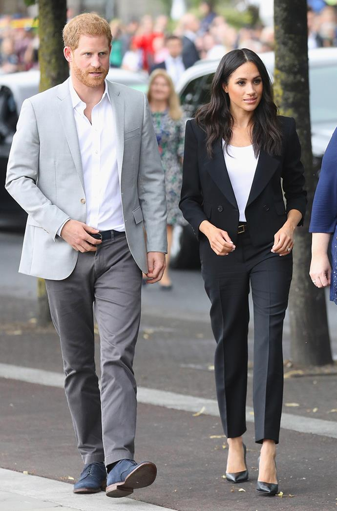 "**MEGHAN, DUCHESS OF SUSSEX** <br><br> While visiting Ireland in July 2018, the Duchess of Sussex wore a custom suit by Givenchy, paired with a matching Givenchy belt. Givenchy has proven to be one of Meghan's favourite designers, with the label's artistic director Clare Waight Keller creating her [highly anticipated wedding dress](https://www.elle.com.au/culture/meghan-markle-wedding-dress-details-17582|target=""_blank"")."