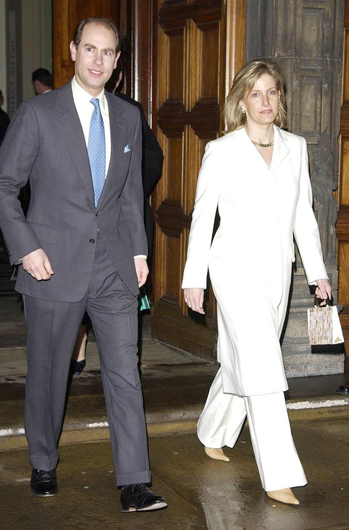 "**SOPHIE, THE COUNTESS OF WESSEX** <br><br> Back in February 2005, the Countess of Wessex looked rather fashionable while attending the reception for the V&A's exhibition ""Style and Splendour Queen Maud of Norway's Wardrobe 1896-1938"". She wore a white suit, along with a gold chain, nude bag, and beige heels."