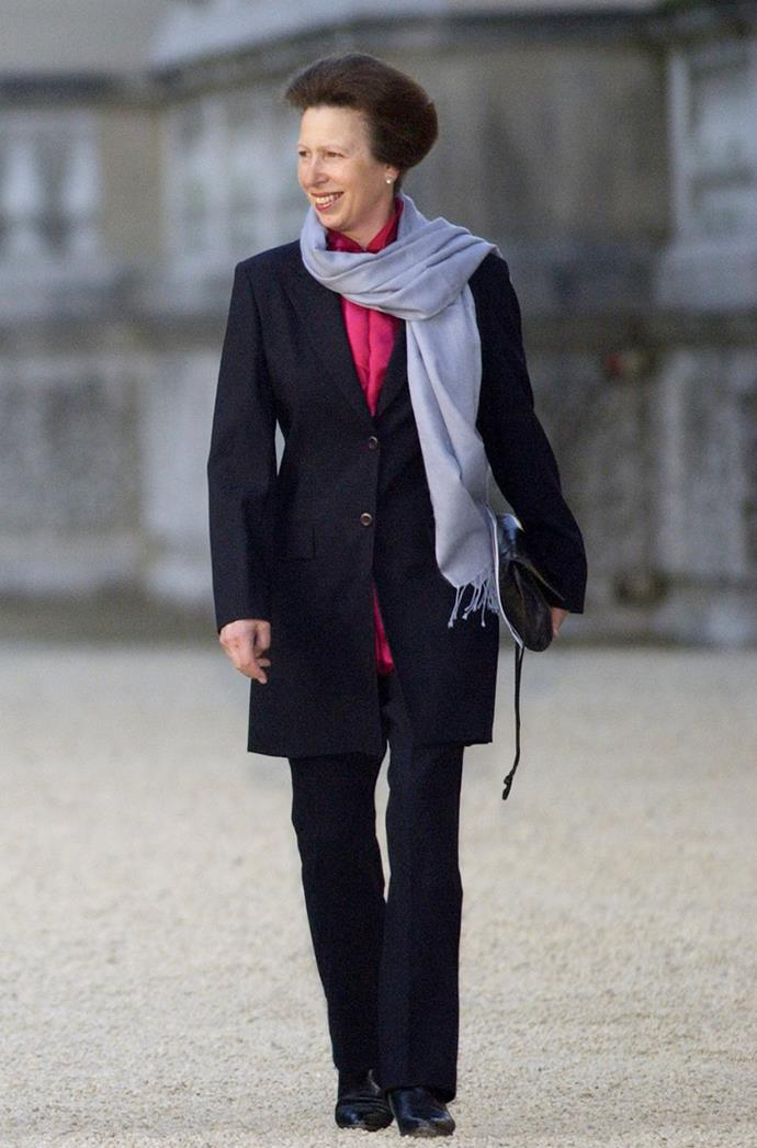 **ANNE, PRINCESS ROYAL** <br><br> Princess Anne attended an event for the Queen's Golden Jubilee on the Buckingham Palace grounds IN May 2002, wearing a navy suit, which she matched with a pink shirt for a touch of color.