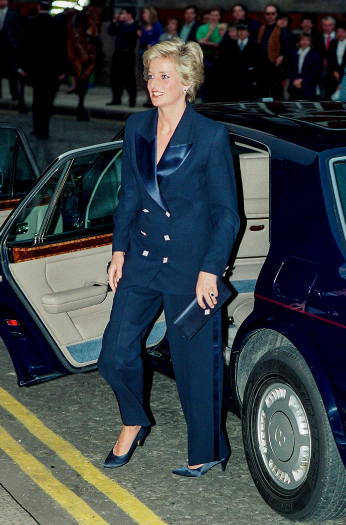 **DIANA, PRINCESS OF WALES** <br><br> In 1990, Princess Diana attended a charity concert at London's Albert Hall in a head-to-toe blue pant suit—accented with a bold red lip.