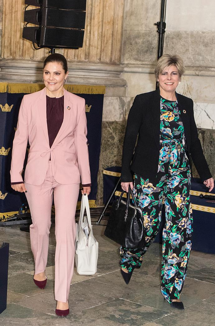 **PRINCESS VICTORIA OF SWEDEN** <br><br> Princess Victoria proved that even royals can sport pink pant suits. Wearing her own—featuring a sweet bow tie—her suit was accented with a purple shirt and matching heels at the 2018 Global Child Forum in Stockholm.