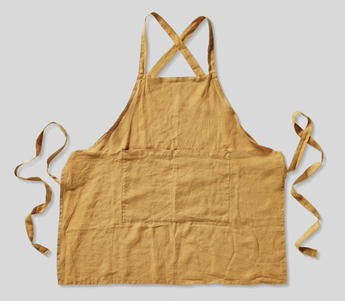 "100% Linen Apron in Mustard, $38 by [IN BED](https://inbedstore.com/collections/aprons/products/100-linen-apron-in-mustard|target=""_blank""
