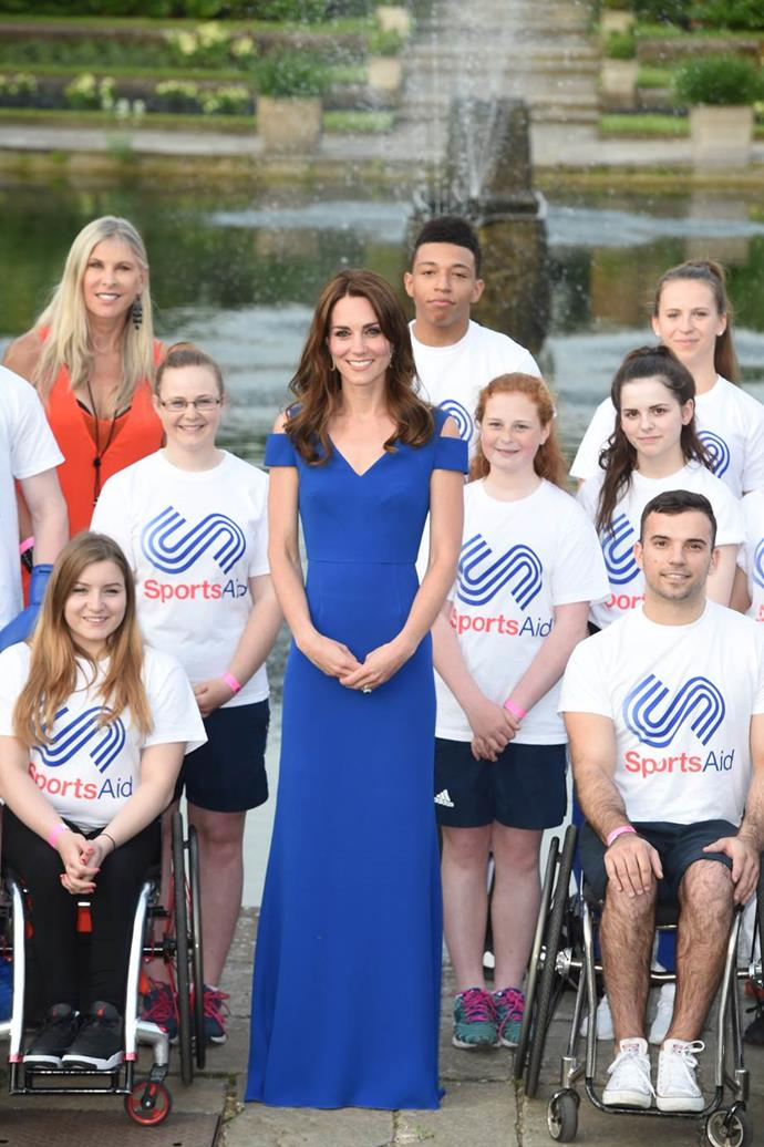 Catherine, Duchess of Cambridge, attending a SportsAid event in a full-length Roland Mouret gown.