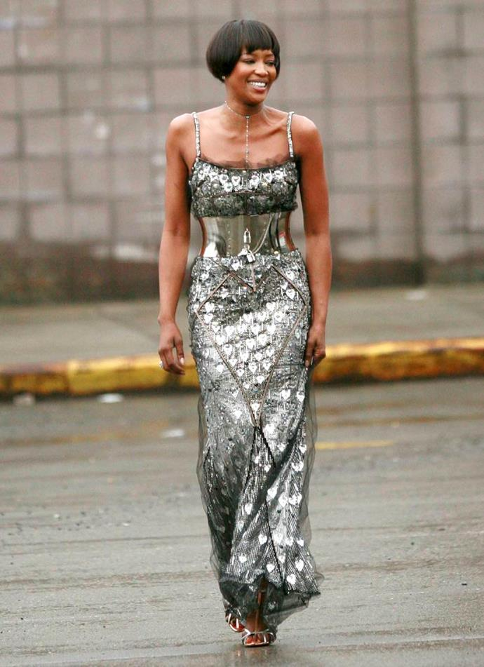 Naomi Campbell completing her community service in a floor-length silver gown by Dolce & Gabbana.