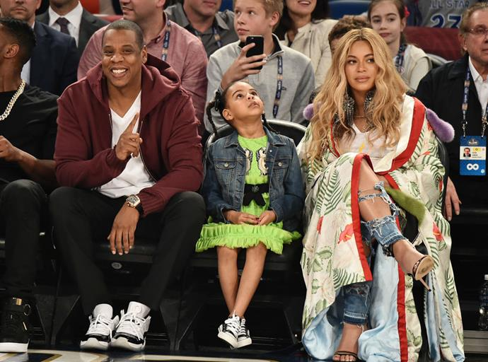 Beyoncé wearing a $30,000 Gucci kimono to the basketball with husband Jay Z and daughter Blue Ivy.