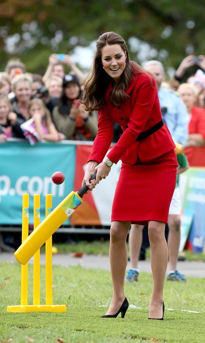 Kate Middleton enjoying a quick spot of cricket in a skirt suit and high heels.