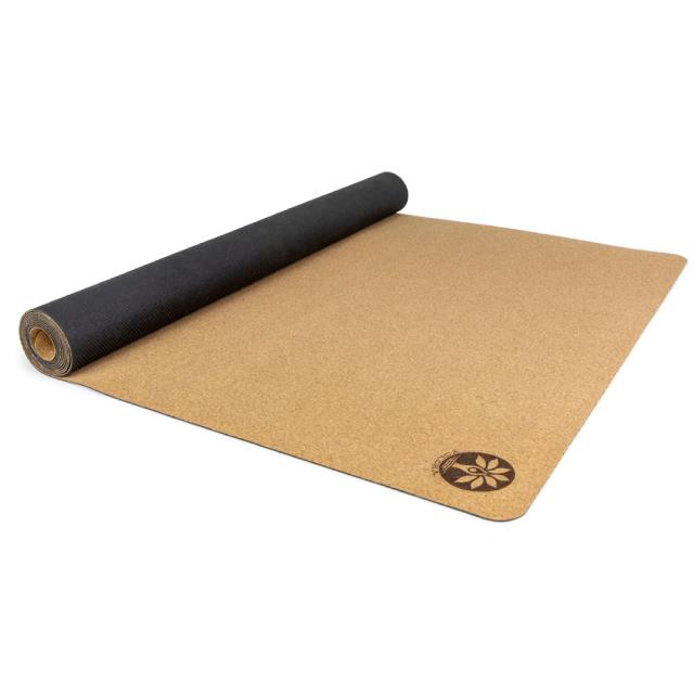 "Travel Cork Yoga Mat, $49 at [Yoloha](https://yolohayoga.com/product/travel-cork-yoga-mat/|target=""_blank""
