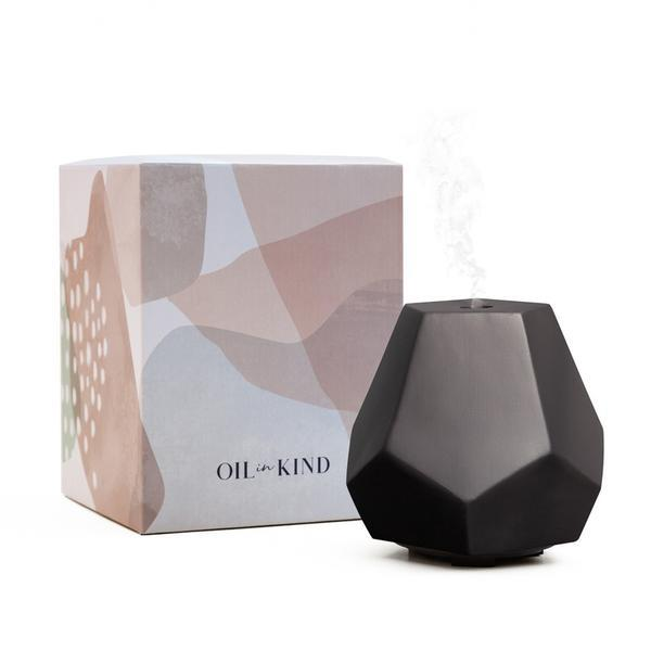 """**Geo Design Diffuser in Charcoal Ceramic, $135 from [Oil in Kind](https://go.skimresources.com?id=105419X1569491&xs=1&url=https%3A%2F%2Foilinkind.com%2Fcollections%2Fdiffusers%2Fproducts%2Fgeo-design-diffuser-charcoal-ceramic