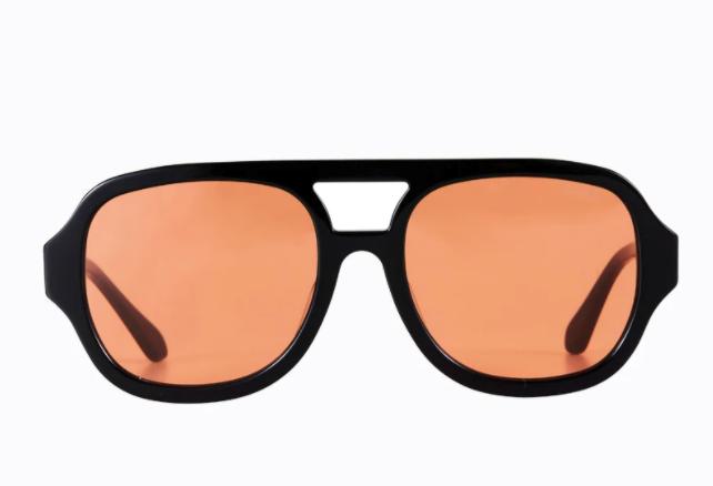 "Jimbob Sunglasses, $140 by [Poppy Lissiman](https://poppylissiman.com/products/sunglasses/jimbob-black-orange|target=""_blank""|rel=""nofollow"")."