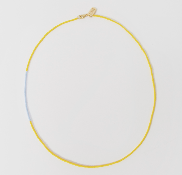 "Multi-Beaded Necklace by Albus Lumen, $110 at [My Chameleon](https://www.mychameleon.com.au/fashion/jewellery/necklaces/multi-beaded-necklace-yellow-blue-albus-lumen|target=""_blank""|rel=""nofollow"")."