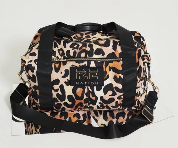 "Set Shot Gym Bag by P.E. Nation, $229 at [Style Runner](https://www.stylerunner.com/products/pe-nation-set-shot-gym-bag-20pe4a090-blk|target=""_blank""|rel=""nofollow"")."