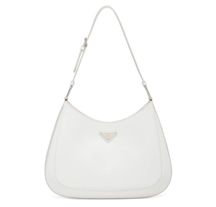 "'Cleo' Shoulder Bag, $3,100 by [Prada](https://www.prada.com/au/en/products.prada_cleo_brushed_leather_shoulder_bag.1BC156_ZO6_F0009_V_OOO.html?utm_campaign=GoogleShopping_AU&utm_medium=CPC&utm_source=Google&utm_content=Shopping&s_kwcid=AL!8549!3!328738273143!!!g!838975125015!&gclid=Cj0KCQiAtqL-BRC0ARIsAF4K3WHoiNINmQx648QODQFdjIPVtIXynWPqstMhfD08sn7YRrOXx2PNeIMaAkfMEALw_wcB&gclsrc=aw.ds|target=""_blank""|rel=""nofollow"")."