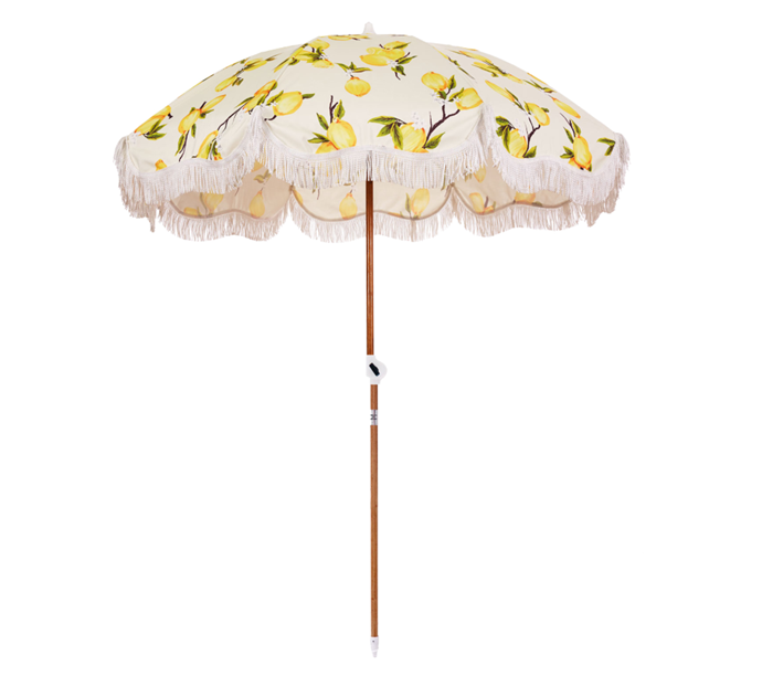 """**The Printed Parasol Beach Umbrella**<br><br>  If you enjoy playful prints and old school parasols, you can't go past the designs from Australian beach accessory brand Business & Pleasure Co. From vintage lemons (as seen here) to tie-dye and classic stripes, you can find their entire collection [here](https://businessandpleasureco.com.au/collections/all-beach-umbrellas