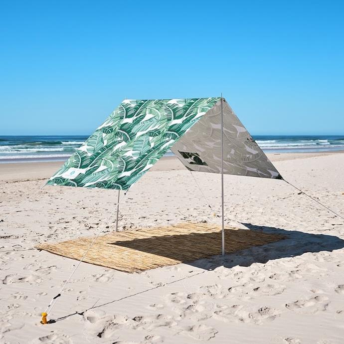 """**The Beach Umbrella-Meets-Tent**<br><br>  Need something a little more spacious? Consider the beach umbrella's big sister: the beach tent. Coming in different prints and offering plenty of shade, you can set these up in multiple ways, including a high sun (""""V"""" shape setup) and low sun (""""L"""" shape setup) formation.<br><br>   *Beach Tent in 'The Tropics' by Byron Bay Beach Life, available in a variety of prints, $164 at [Byron Bay Beach Life](https://www.byronbaybeachlife.com.au/collections/beach-tents